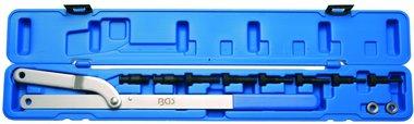 Outil de blocage de poulies avec tenons echangeables